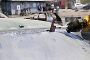 Firefighter uses an axe to break the front windshield of a car to rescue the trapped driver and passengers