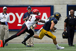 BERKELEY, CA - SEPTEMBER 12:  Tight end Raymond Hudson #11 of the California Golden Bears is pushed out of bounds by defensive back Malik Smith #12 of the San Diego State Aztecs during the second quarter at California Memorial Stadium on September 12, 2015 in Berkeley, California. The California Golden Bears defeated the San Diego State Aztecs 35-7. (Photo by Jason O. Watson/Getty Images) *** Local Caption *** Raymond Hudson; Malik Smith