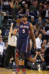 February 25, 2011; Oakland, CA, USA;  Atlanta Hawks power forward Josh Smith (5) celebrates after making a basket while fouled against the Golden State Warriors during the first quarter at Oracle Arena. Atlanta defeated Golden State 95-79.