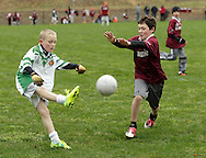 Monroe, New York - A St. Brendan's Gaelic Football Club player tries to block a kick by a Rockland Gaelic Athletic Association player in a 12-and-under game on March 31, 2012. ©Tom Bushey / The Image Works