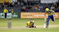 Matt Taylor of Gloucestershire tries to run out Aneurin Donald of Glamorgan - Mandatory by-line: Robbie Stephenson/JMP - 10/06/2016 - CRICKET - Brightside Ground - Bristol, United Kingdom - Gloucestershire v Glamorgan - NatWest T20 Blast