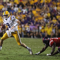 Sep 29, 2018; Baton Rouge, LA, USA; LSU Tigers quarterback Joe Burrow (9) runs against the Mississippi Rebels during the second quarter of a game at Tiger Stadium. Mandatory Credit: Derick E. Hingle-USA TODAY Sports