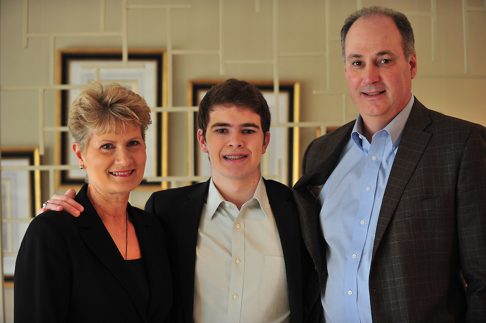 Judy Pesek Skipper and Ron Skipper pose for a portrait in their home with son Kyle Skipper  on Sunday, March 3, 2013. (Cooper Neill/The Dallas Morning News)