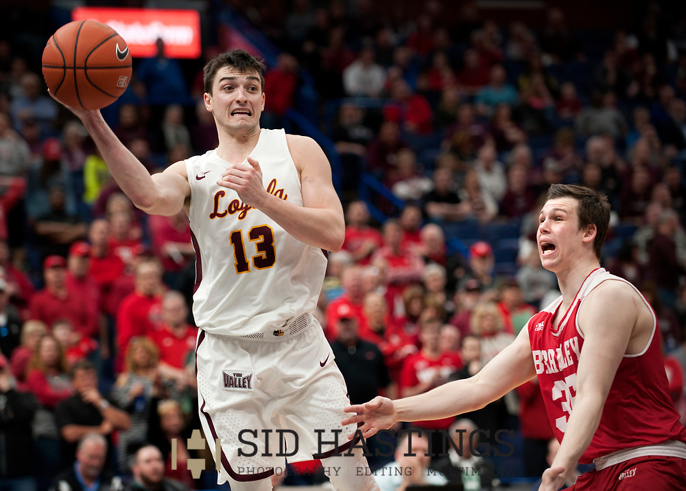 Loyola University Chicago basketball player Clayton Custer (13) looks to pass against Bradley University's Jayden Hodgson (35) during the semifinals of the Missouri Valley Conference men's basketball tournament at Scottrade Center in St. Louis Saturday, March 3, 2018. LUC won, 62-54. Photo © copyright 2018 Sid Hastings.