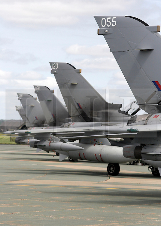 © under license to London News Pictures. 08/04/11 Prime Minister David Cameron is to look again at cuts to the defence budget. According to the reports, plans to scrap RAF Tornados and surveillance planes may be reversed. FILE PICTURE DATED 03/06/09. RAF Tornado fighter bombers at the dispersal area at RAF Marham in Norfolk. Credit should read Matt Cetti-Roberts/LNP