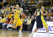26 JANUARY 2009: Iowa guard Kamille Wahlin (2) calls out a play while bringing the ball down court during the first half of an NCAA women's college basketball game Monday, Jan. 26, 2009, at Carver-Hawkeye Arena in Iowa City, Iowa. Iowa defeated Michigan 77-69.