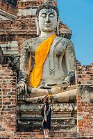 tourist in front of buddha statue Wat Yai Chai Mongkhon Ayutthaya Bangkok Thailand