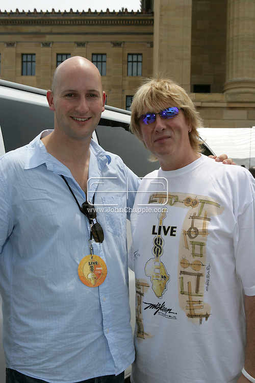 2nd July 2005, Philadelphia, PA. The USA Live 8 concert held in the city of Philadelphia. Pictured is Mirror reporter Ryan Parry with Joe Elliott from Def Leppard. PHOTO © JOHN CHAPPLE IN THE BIG APPLE. Tel (001) 212 397 7287.www.chapple.biz