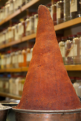"""Middle East, Israel, Jerusalem,  giant cone of red spice at Mahane Yehuda Market (also known as Machaneh Yehuda), often referred to as """"The Shuk"""", is popular with locals and tourists alike, the market's more than 250 vendors sell fresh fruits and vegetables; baked goods; fish, meat and cheeses; nuts, seeds, and spices; wines and liquors; clothing and shoes; housewares, textiles, and even Judaica."""