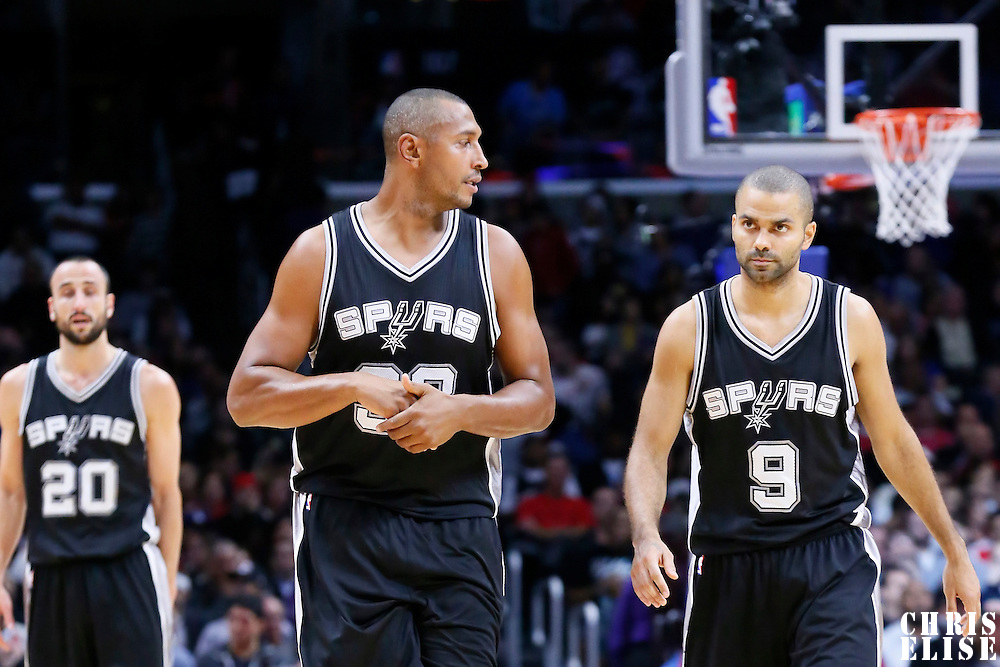 10 November 2014: San Antonio Spurs forward Boris Diaw (33) talks to San Antonio Spurs guard Tony Parker (9) during the San Antonio Spurs 89-85 victory over the Los Angeles Clippers, at the Staples Center, Los Angeles, California, USA.