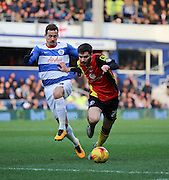 Birmingham City midfielder, Jon Toral (20) battling with Queens Park Rangers midfielder, Daniel Tozser (28) during the Sky Bet Championship match between Queens Park Rangers and Birmingham City at the Loftus Road Stadium, London, England on 27 February 2016. Photo by Matthew Redman.