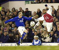 Photo. Jed Wee.<br /> Everton v Arsenal, FA Barclaycard Premiership, Goodison Park, Liverpool. 07/01/2004.<br /> Everton's Tony Hibbert (L) and Arsenal's Ashley Cole both go for the same ball.