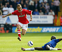 Photo: Chris Ratcliffe.<br />Charlton Athletic v Chelsea. The Barclays Premiership. 17/09/2005.<br />Dennis Rommedahl jumps clear of Claude Makelele of Chelsea