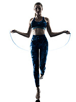 one caucasian woman exercising fitness Jumping Rope excercises in silhouette isolated on white background