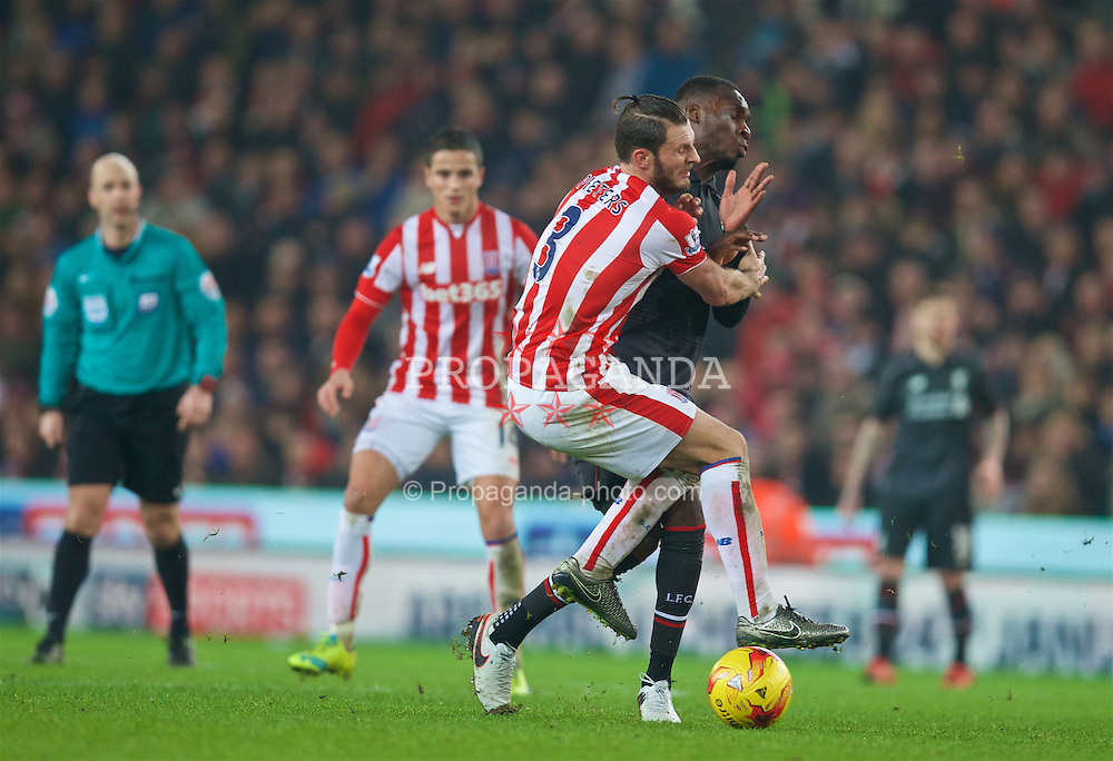 STOKE-ON-TRENT, ENGLAND - Tuesday, January 5, 2016: Liverpool's Christian Benteke in action against Stoke City's Erik Pieters during the Football League Cup Semi-Final 1st Leg match at the Britannia Stadium. (Pic by David Rawcliffe/Propaganda)