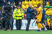 Livingston manager Gary Holt celebrates with his players after the final whistle of the Ladbrokes Scottish Premiership match between Livingston FC and Celtic FC at The Tony Macaroni Arena, Livingston, Scotland on 6 October 2019.