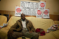 Luis Mendes sits on his sofa on January 10 of 2011 at his home in Torrejon de Ardoz, Madrid, Spain. .Luis Mendes is currently an unemployed builder, 45 years old, from Guinea Bissau, and has a wife and 8 children to maintain in Senegal. He lives at his home in Torrejon De Ardoz, Madrid, with his brothers. .Today he is facing a second eviction attempt as he stopped paying the mortgage to Bankia Bank when lost his job in 2009 during the economic crisis. He had to choose between feeding his children or paying the bank. At the moment, he cannot even send money anymore to his family and if he losses his current house, he would gain a live-long debt. He has tried to negotiate with the bank to reach a different solution, by paying a lower monthly fee, but up to now there was no agreement for it..This is also case of many people in Spain that are losing their homes every-days and also gaining debts to banks..According to details of the General Council of the Judiciary, in Madrid there are 40 evictions every-days.