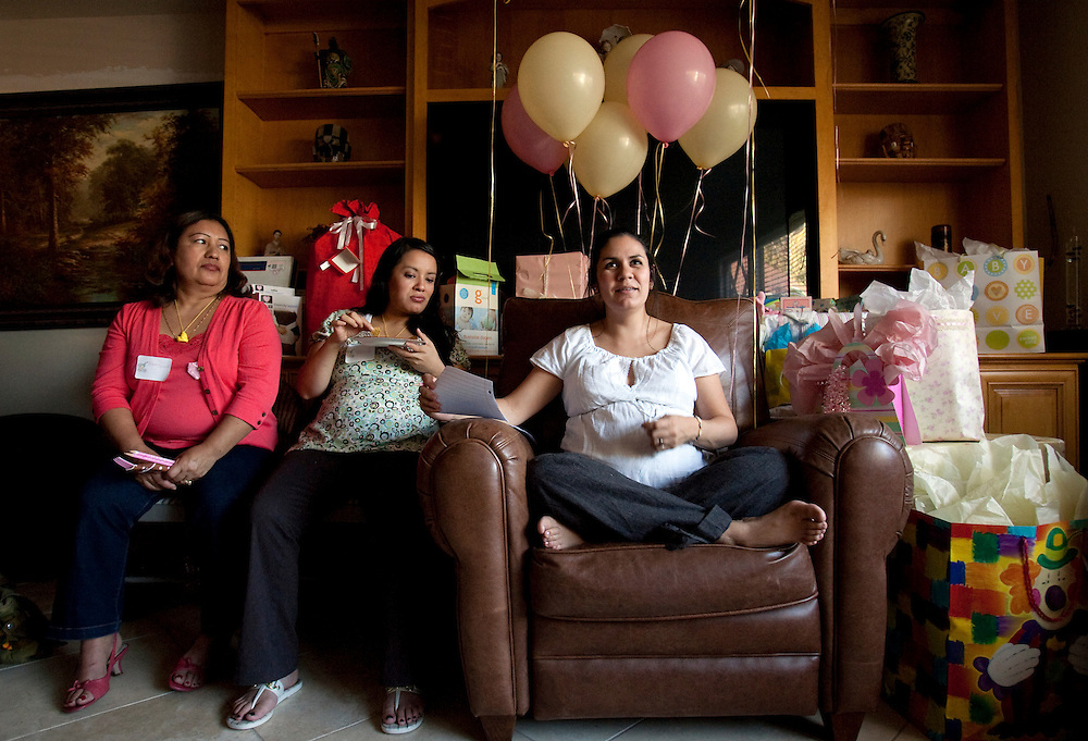 Alma Stauth, in white, at her baby shower. Alma is an undocumented immigrant who was brought here as a toddler and is facing deportation and separation from her family. Alma Stauth is a undocumented immigrant who was brought to this country when she was a young girl by her parents. Pregnant with her first child with her husband, Eric, she faces deportation to Mexico despite Eric's status as a US citizen. Please contact Todd Bigelow directly with your licensing requests.