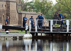 © Licensed to London News Pictures. 09/09/2014. Hanwell, UK. Officers search next to Hanwell Lock.  Police continue to cordon off a section of the Grand Union Canal in Isleworth in the search for missing school girl Alice Gross today 9th September 2014.  Alice Gross of Hanwell, west London, was last seen by her family at about 13:00 BST on 28 August. CCTV footage shows her walking along the Grand Union Canal tow path near the Holiday Inn at Brentford Lock between 13:30 BST and 17:30 BST.. Photo credit : Stephen Simpson/LNP