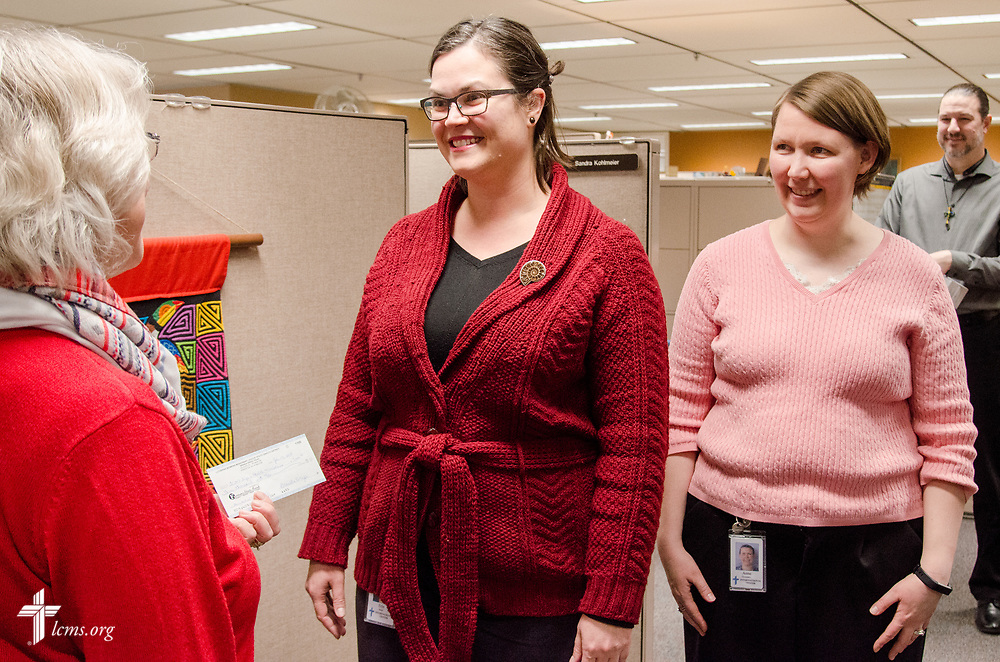 Lisa Asmus, left, president of the LWML South Dakota District, presents a check for $3,000 to Erin Alter, director of Short-Term Mission Teams for the LCMS Office of International Mission, on Wednesday, Jan. 24, 2018, at the LCMS International Center in St. Louis. The gift was a South Dakota District mission grant for the 2016-18 biennium, and the funds will be used to help pay the costs of sending a chaplain on a mission trip with a Mercy Medical Team. Pictured behind Alter is, from left, Anne Gonzalez, manager of Short-Term Training and Engagement; and David Fiala, assistant director of Missionary Recruitment. LCMS Communications/Frank Kohn
