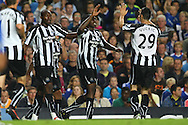 London - Wednesday September 22nd 2010: Nile Ranger of Newcastle scores his sides equalising goal and celebrates with Shola Ameobi and Vuckic during the Carling Cup 3rd Round match at Stamford Bridge, London. (Pic by Paul Chesterton/Focus Images)
