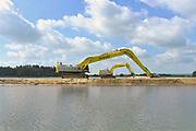 Nederland, Kekerdom, 31-5-2017 Nieuwe geul in natuurgebied de Millingerwaard staat in verbinding met de rivier de Waal, Rijn. Het gewonnen zand is verkocht als grondstof. In het kader van ruimte voor de rivier is dit project daarmee klaar. De steenfabriek is ontmanteld en mag instorten.Foto: Flip Franssen