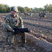Soldier from 3 SCOTS (The Black Watch) patrol back to camp  several hours after Private Stephen Bainbridge, aged 25, from Kirkcaldy becomes gravely wounded in an IED explosion in the same dorway which traumatically amputated his right leg and damaged his right so badly that it too later had to be amputated. His life was saved by the swift actions of Cpl John Goodie (21) a medic with 1 PWRR (The Princess of Wales's Royal Regiment) who applied tourniquets and first field dressings to get the bleeding under control. Private Chis Watson (21) also assisted in the treatment whilst reassuring the casualty and keeping him alert and responsive.  Once he had been stabilized the men CASEVAC'd Private Bainbridge to the MERT helicopter and he was rushed to Bastion Field Hospital.  Loya Manda, Nad e Ali, Helmand Province, Afghanistan on the 11th of November 2011.
