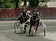 Goshen, NY Two horses head around a turn during a harness race at Goshen's Historic Track on June 7, 2008.