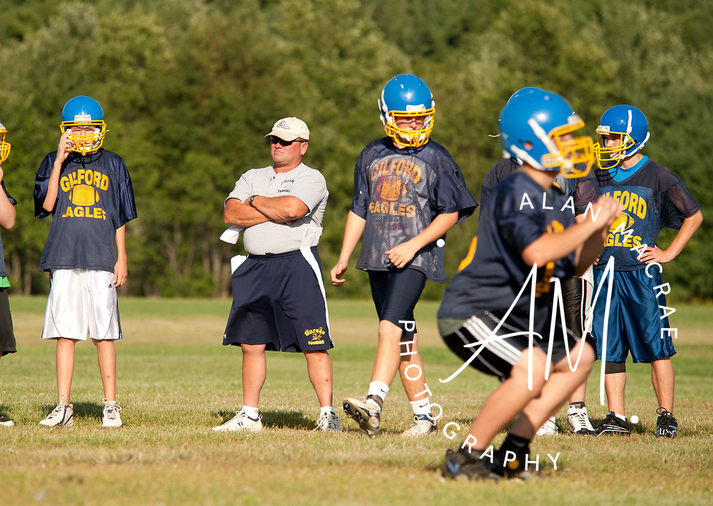 Gilford Golden Eagles football team go through their paces under the watchful eye of head coach Mark Brewer on Wednesday, August 11, 2010.  (Alan MacRae/for the Citizen)