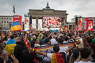 Berlin, Germany - 12.06.2016 <br /> <br /> European Football Championship 2016 fan mile at the Brandenburg Gate. Football fans watching at the public viewing on the Stra&szlig;e des 17. Juni in Berlin the Euro-2016 football match between Germany and Ukraine .<br /> <br /> Fanmeile am Brandenburger Tor zur Fussball-Europameisterschaft 2016. Fussballfans verfolgen beim Public Viewing auf der Stra&szlig;e des 17. Juni das Euro-2016 Fussballspiel zwischen Deutschland und der Ukraine.<br /> <br /> Photo: Bjoern Kietzmann