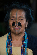Apatani woman &amp; facial tattoos &amp; nose plugs or Yapin Hulo<br /> These plugs are made of a cane slice. This practice was to make them look unattractive to males from other tribes. These facial modifications are not longer used and has been outlawed<br /> Apatani Tribe<br /> Ziro Valley, Lower Subansiri District, Arunachal Pradesh<br /> North East India