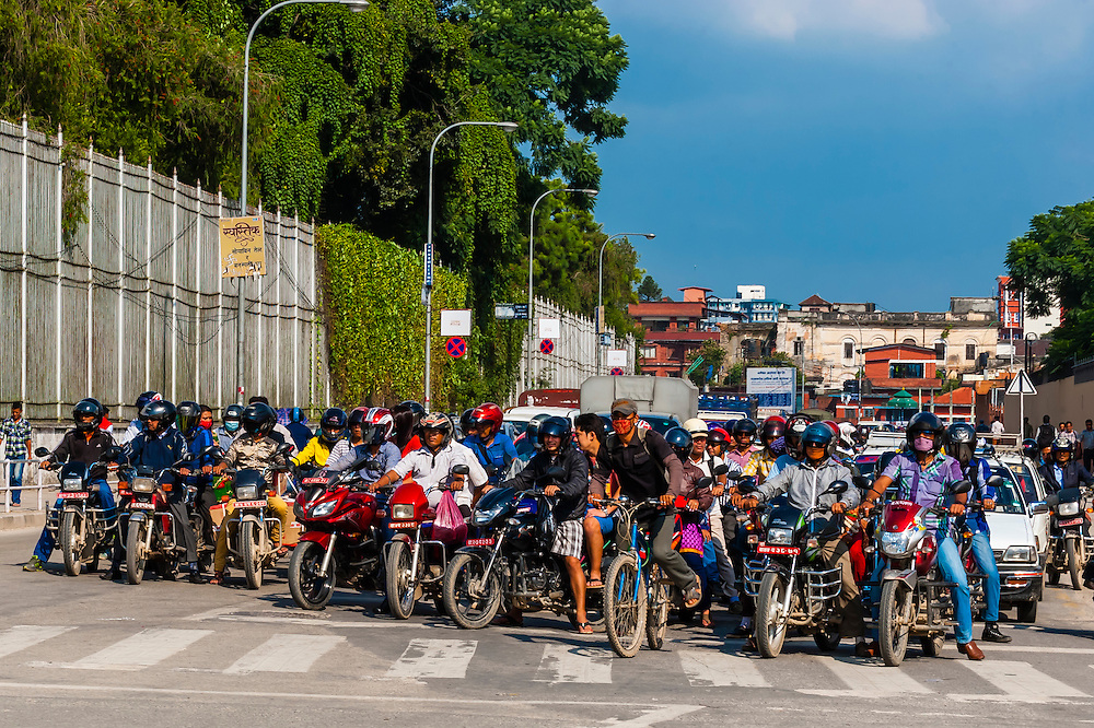 Two wheeled traffic waiting for a light to change, Kathmandu, Nepal.