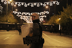 Riot police officer and Christmas decoration during a protest march hold by leftist groups to mark the 8th anniversary of the murder of Alexandros Grigoropoulos who was shot dead by police officer Epaminondas Korkoneas in 2008. Athens, Greece, December 6, 2016. Photo by Panayotis Tzamaros/ABACAPRESS.COM