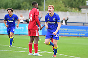 AFC Wimbledon Midfielder Alfie Egan (28) scores and celebrates a late goal 3-2 during the Pre-Season Friendly match between AFC Wimbledon and Watford at the Cherry Red Records Stadium, Kingston, England on 15 July 2017. Photo by Jon Bromley.