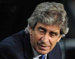 Manchester City Manager, Manuel Pellegrini closes his eyes - Photo mandatory by-line: Dougie Allward/JMP - Mobile: 07966 386802 - 18/03/2015 - SPORT - Football - Barcelona - Nou Camp - Barcelona v Manchester City - UEFA Champions League - Round 16 - Second Leg