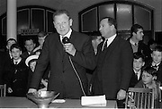 25/03/1966<br /> 03/25/1966<br /> 25 March 1966<br /> Córas Tráchtála award in Irish Boat show.  At the Irish Boat Show organised by the Irish Yachting Association at the RDS, Ballsbridge, Dublin Mr John Haughey, Chairman, Córas Tráchtála presented a silver bowl as a perpetual award for the best professionally built and finished boat in the Show. Picture shows Mr. John Haughey (left) announcing the winner with Mr John Walker, Honorary Secretary Irish Boat Show Committee, on right. .