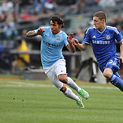 Carlos Tevez, Manchester City, (left) is challenged by Anreas Christensen, Chelsea, in action during the Manchester City V Chelsea friendly exhibition match at Yankee Stadium, The Bronx, New York. Manchester City won the match 5-3. New York. USA. 25th May 2012. Photo Tim Clayton