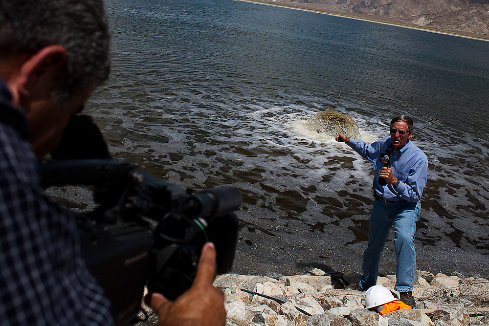 Gene Gleeson of ABC7 News of Los Angeles does a stand-up for a story about the Los Angeles Department of Water and Power's dust mitigation project on the Owens dry lake.  DW&P is entering the tenth year of a dust mitigation project on the lake, part of a mediated settlement between the utility and the residents of the valley, whose health were being damaged by particles blown off the lake by the constant winds.   August 5, 2009.