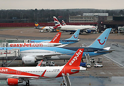 File photo dated 08/03/17 of aeroplanes at Gatwick Airport in West Sussex. Workers who assist passengers at one of the country's busiest airports will stage a series of strikes in a dispute over pay.