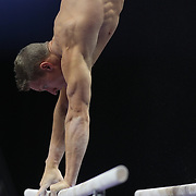 Steven Legendre, Norman, Oklahoma, shows his muscles and physique during warm up on the Parallel bars before competiton during the Senior Men Competition at The 2013 P&G Gymnastics Championships, USA Gymnastics' National Championships at the XL, Centre, Hartford, Connecticut, USA. 16th August 2013. Photo Tim Clayton