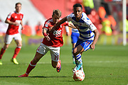 Reading midfielder Jordan Obita (11) holds off Nottingham Forest forward Jamie Ward (19) during the EFL Sky Bet Championship match between Nottingham Forest and Reading at the City Ground, Nottingham, England on 22 April 2017. Photo by Jon Hobley.
