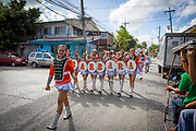 Young women and men taking part in a parade for Santa Barbara in front of a police station in Manila, Metro Manila, Philippines.  (photo by Andrew Aitchison / In pictures via Getty Images)