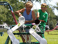 Jane Meisheid (from left) and Gus Joyce, 7, both of Walker compete in the Pickle Boat Race at the Walker Pickle Days in Walker on Saturday, July 30, 2011. Activities included a 5K run/walk, kid's fun run, horseshoe tournament, craft show, backyard games tournament, parade, and fireworks.