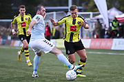 Harrogate Town forward Jack Muldoon (18) gets passed Braintree Town defender Joe Ellul (17) during the Vanarama National League match between FC Halifax Town and Dover Athletic at the Shay, Halifax, United Kingdom on 17 November 2018.
