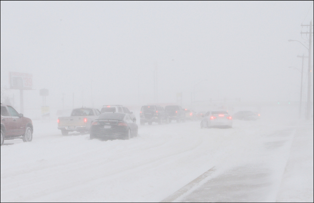 Interstate 35 through the heart of Oklahoma City at a standstill due to hazardous conditions during a Blizzard.