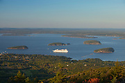A cruise ship sails among the Porcupine Islands in Bar Harbor, Maine. This view was captured from the summit of Cadillac Mountain in Acadia National Park, which at 1,532 feet, is the highest point along the North Atlantic seaboard.