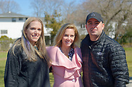 North Merrick, New York, USA. March 31, 2018. At center, Hempstead Town Supervisor LAURA GILLEN poses with L-R, SUE MOLLER and LOU CICCONE, co-Presidents of North and Central Merrick CIvic Association, at the 16th Annual Eggstravaganza, held at Fraser Park. Event was co-hosted by NCMCA and  American Legion Auxiliary Unit 1282.