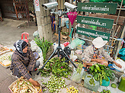 15 JUNE 2105 - NARATHIWAT, NARATHIWAT, THAILAND:   Market vendors work under a CCTV camera that records car license plates in Narathiwat. Thailand makes extensive use of CCTV to monitor for insurgents. There is a Muslim insurgency against the central government active in Narathiwat, Pattani and Yala. About 6,000 people have been killed in the 10 year old insurgency.     PHOTO BY JACK KURTZ