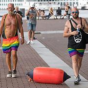 NLD/Amsterdam/20180604 - Gaypride 2018, oudere homo's in badpak met regenboog sportbroek