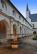 Fountain and west gallery of the main Grand-Moutier Cloister at Fontevraud Abbey, Fontevraud-l'Abbaye, Loire Valley, Maine-et-Loire, France. The cloister, built to house virgin nuns, was originally Romanesque but was rebuilt in the 16th century. Renee de Bourbon renovated the south gallery in Gothic style in 1519, then Louise de Bourbon rebuilt the 3 other galleries in classical style 1530-60. The abbey was founded in 1100 by Robert of Arbrissel, who created the Order of Fontevraud. It was a double monastery for monks and nuns, run by an abbess. The abbey is listed as a historic monument and a UNESCO World Heritage Site. Picture by Manuel Cohen
